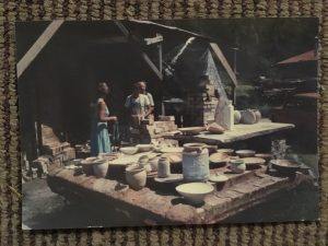 People in kiln shed with pottery