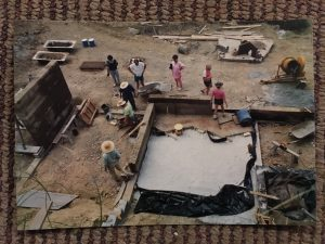 People pouring concrete seen from above